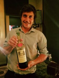 Adrien with a bottle of Chateau Coutet Cuvee Emeri