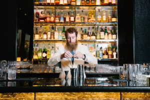 Thomas Waugh tends the bar at The Pool Room Lounge, NYC