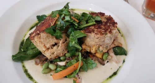 Griddle Seared Gulf Fishcakes, smoked redfish over Louisiana soybeans, local mushrooms, roasted squash and truffled cauliflower cream.
